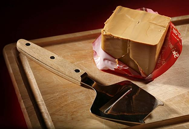 "Gjetost (or brunost). Sweet, ""caramely"" Norwegian cheese. Delicious with apples!"
