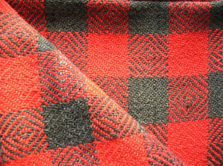 A blanket made from hand spun and naturally dyed wool, woven a century ago by the local weaver.