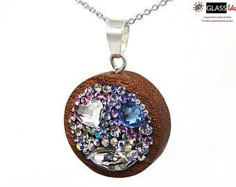 #SterlingSilver #necklace #wood #swarovskiCrystals #rhodiuumplated  #CopyrightGlassideas  #GlassIdeas #Sold #OneOfAKindJewelry #WoodenJewelry #Swarovski #sapele