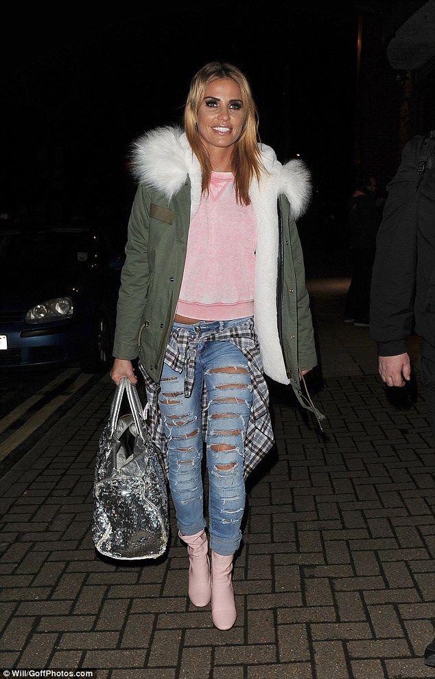 Season's greetings! Katie Price was hard to miss on Thursday as she left the New Victoria ...