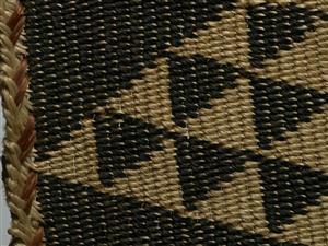 Detail of Kaitaka paepaeroa (fine flax cloak with vertical weft rows and taniko borders) 1800-1840; Te Ati Awa iwi (tribe); muka (flax fibre), natural dye; On loan from David Pitt (DE000107/1)