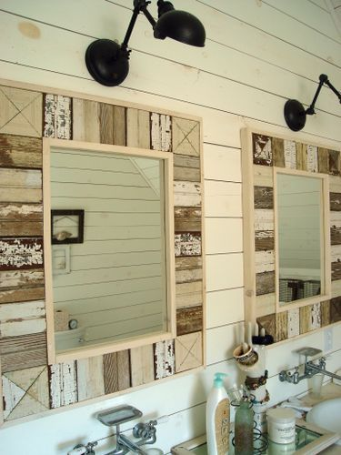 Planked walls, lighting, handmade mirrors from old wainscotting