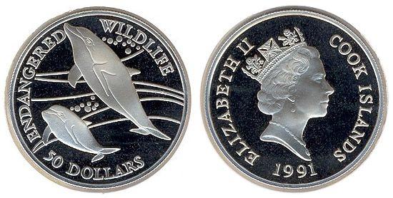 Острова Кука. Монета 50 долларов, черненое серебро. На реверсе изображены два дельфина. Год выпуска 1991.