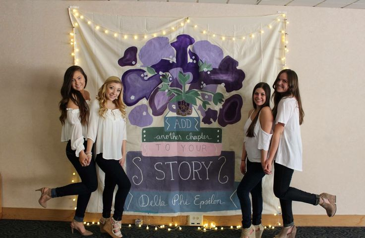 """Add another chapter to your story💕 I painted this banner (freehanded!!) for our fall open house - took me weeks!! The flowers are my interpretive take on the """"lovely purple iris"""" - Delta Phi Epsilon's flower. The mug has our crest on it too! Such a fun project. #dphie #sorority #extra #deltaphiepsilon #dphiesummer #dphietravels #delta #phi #epsilon #recruitment #towson #greek #greeklife"""