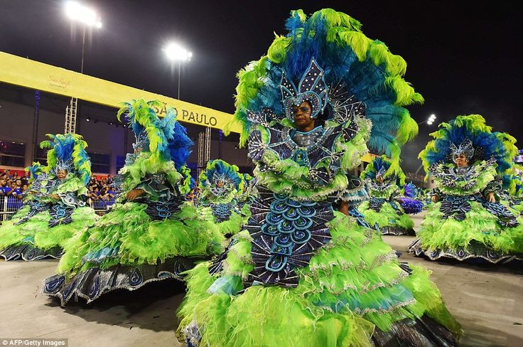 Team of dancers: In Sao Paulo, Brazil's most populous city and its economic capital, carnival celebrations were kicked off under intermittent summer rain, with a tribute to Carlinhos de Jesus, one of Brazil's most famous salon dancers