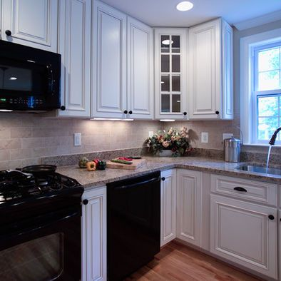 Black refrigerator white cabinets on white kitchen with - Kitchen design with black appliances ...