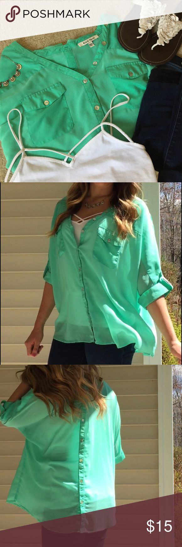 """Mint green blouse Flowing and light weight mint green blouse.  Very vibrant color  Pearl colored buttons.  Buttons all up the front and down the back.  Can unbutton all buttons to creat different looks  Size large worn once  Batwing type of sleeve.  🌺Make me offers  🌺bundle and save  🌺ask me questions  ( model is 5'9"""" and typically wears size small )  ❤ Tops Button Down Shirts"""