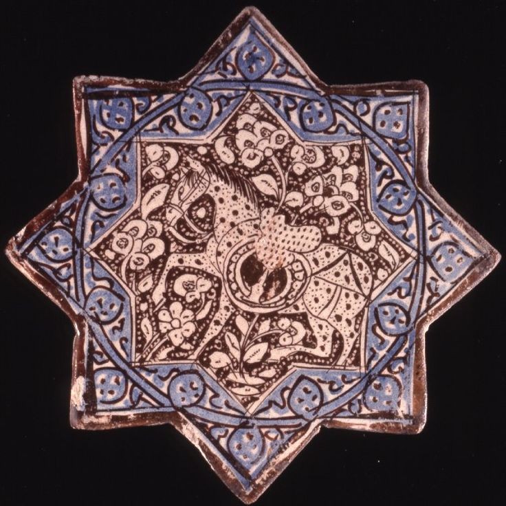 Eight-pointed star tile. Fritware (stonepaste), painted in blue and lustre over an opaque white glaze. The central field is decorated in reserve against a lustred background with saddled horse and foliage. The border is decorated with a frieze of dotted medallions and scrolls, outlined in lustre, coloured in blue and enclosed within lustre lines. Reverse undecorated.