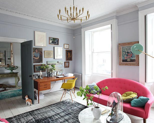 This just confirms my love for gray rooms. I love how the walls are grey, the door is charcoal gray, and the white/black/grey rug in the middle of it all, yet still the room feels bright. Granted, the windows and pops of color help...which brings me to my next reason why I love gray - it works with every color!