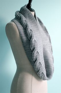 Millwater is a nearly-reversible cowl/infinity scarf with generous proportions (that allow it to be doubled up for extra coziness), and featuring a super-squishy, ribbed, reversible cable — set asymmetrically against a garter stitch background.
