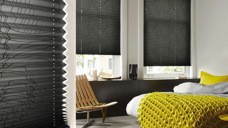 Black and yellow bedroom with dark grey pleated blinds. I like!