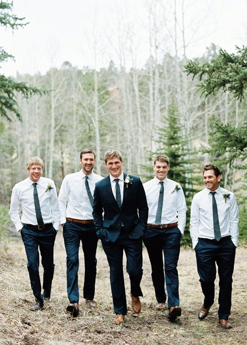 I like how the groom is the one in the suit - maybe put the groomsmen in black shirts with white ties?
