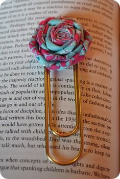 rosette book marks ... there is a link to a vlog to show you how to make the flower ... pretty