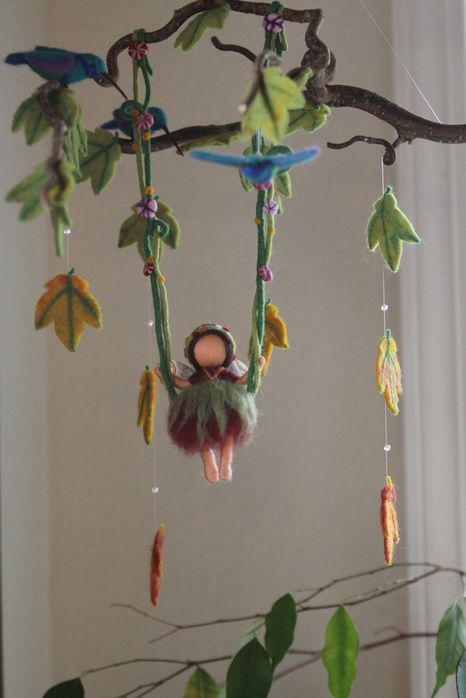 Fairy on a swing mobile