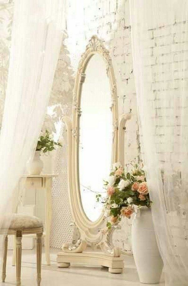 Vintage Chic Stand Mirror and Dropping and Light-colored Window Treatment.