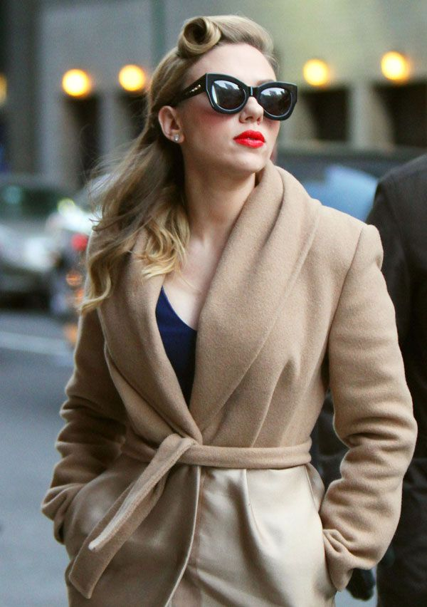 Scarlett Johansson does retro glamour with red lips, vintage hair and supersize sunnies!