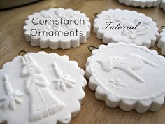 White dough: 1/2 cup cornstarch 1 cup baking soda 3/4 cup water _Bake at 175 degrees F for 45-60 minutes. Then flip over and bake an additional 45-60 minutes, or until all ornaments are hard. Let cool then spray with a clear protective coating (I used Krylon matte finish).
