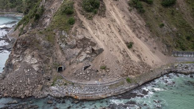 Tonnes of rock and dirt cover SH1, south of Kaikoura.