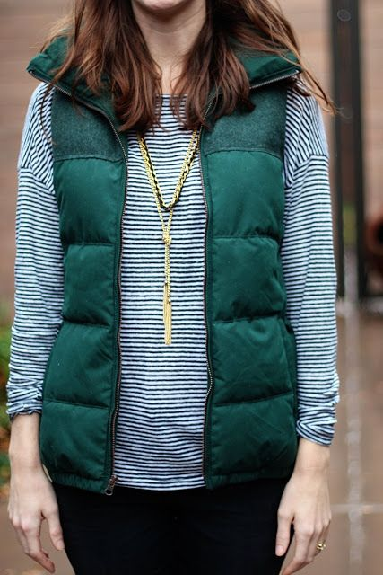 green puffy vest and simple striped t shirt
