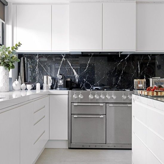 Drama with marble :)   Monochrome kitchen with handleless units