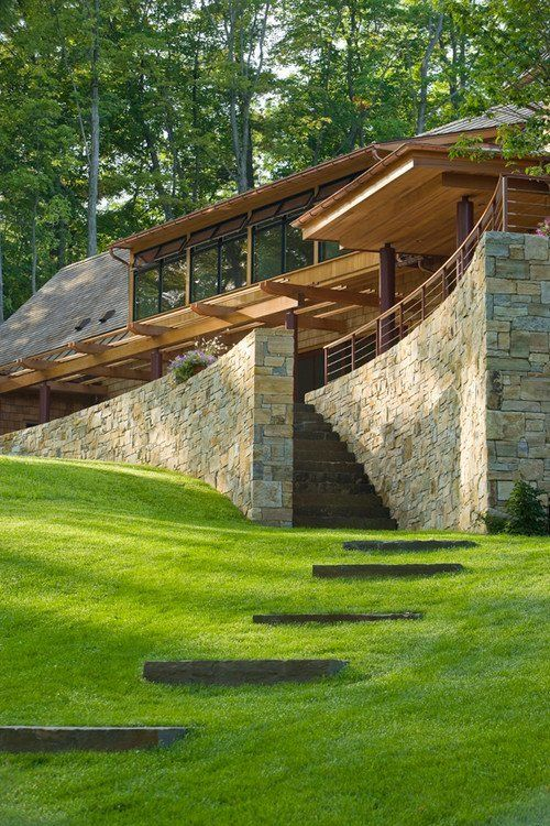 Dramatic scale | Lush grass | Natural timber | Welcoming stonework