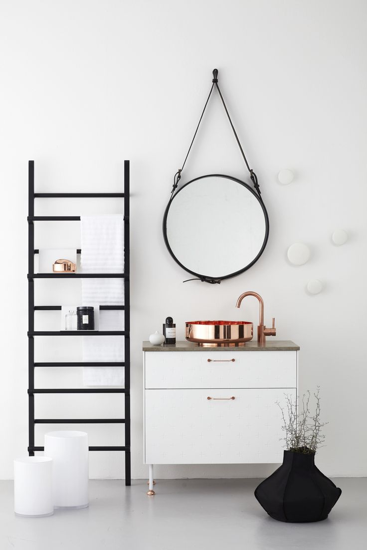 Stylish cabinet for a modern bathroom. Discover more: www.buffetsandcabinet.com | #cabinetdesign #whitecabinet #bathroomcabinet