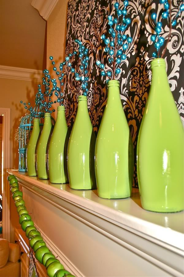 Spray painted wine bottles.