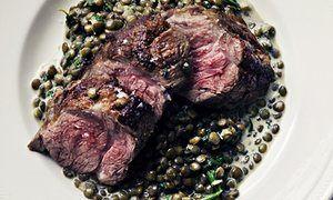 Nigel Slater's spiced lamb fillet on lentils on a plate