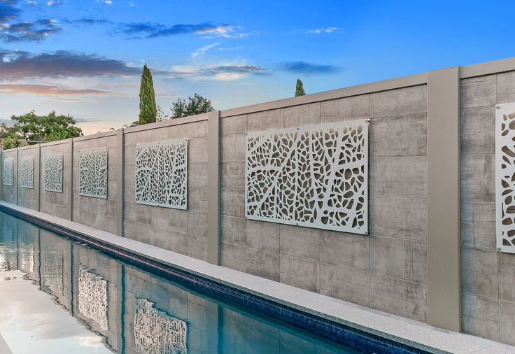 A breathtaking Voguewall  with custom tiled veneer and back lit laser-cut screening.