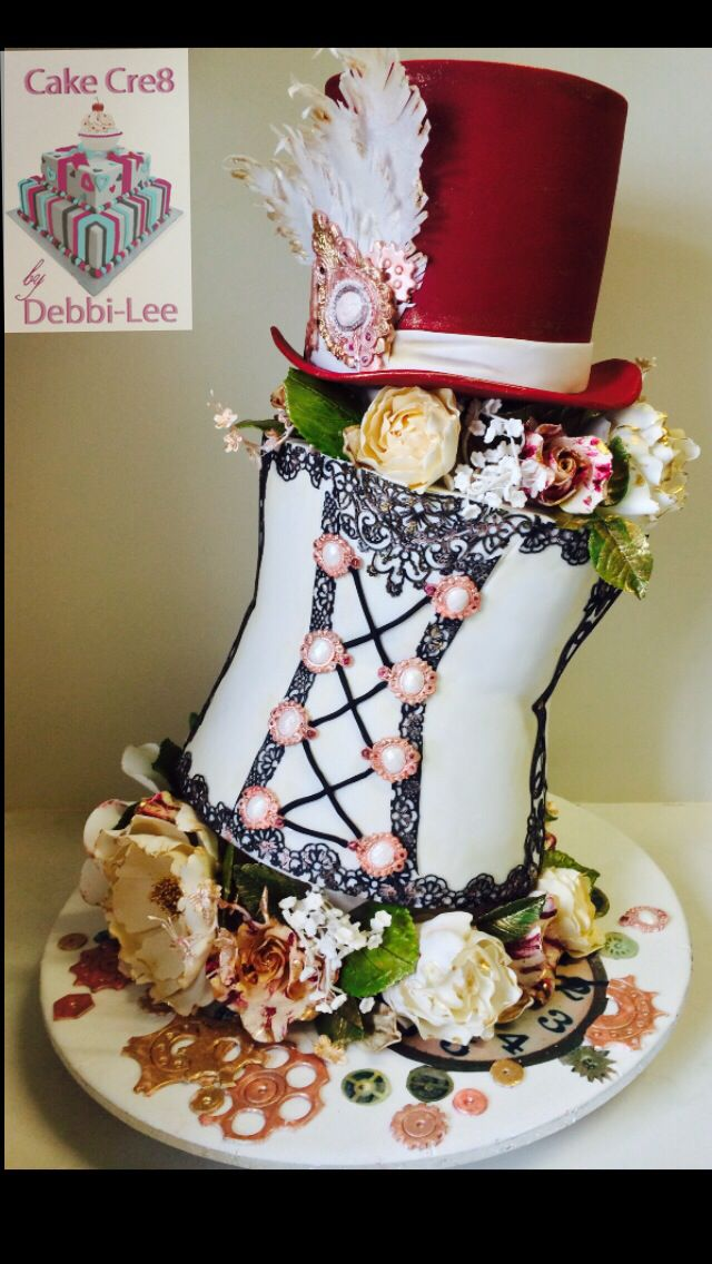 Steampunk corset cake! All edible! Sugar flowers, sugar jewels, wafer paper feathers, cake lace,