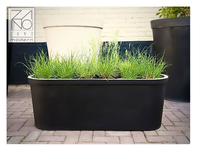 Very durable planter made of resin concrete which is resistant to every weather. Design and functionality.