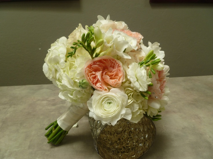Coral David Austin roses, white ranunculus, freesia, hydrangea and roses with rhinestonesDavid Austin Rose
