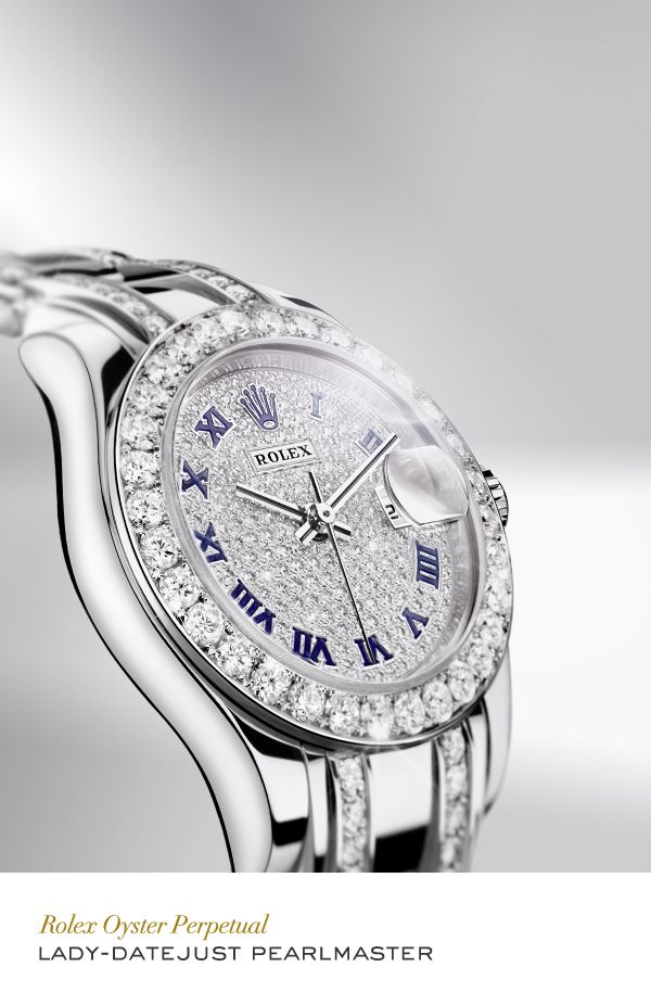 Rolex Lady: Date just Pearlmaster 29 mm in 18 carat white gold with a diamond-set bezel and diamond-paved dial with blue enamel roman numerals and Pearlmaster bracelet.