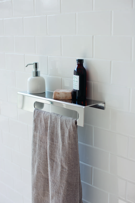 What would you keep on our stainless steel shelves? Stainless steel shelf with a ceramic soap dispenser and a towel rail from Britton Bathrooms. Minimal steel shelf design with that works as a towel rail too.