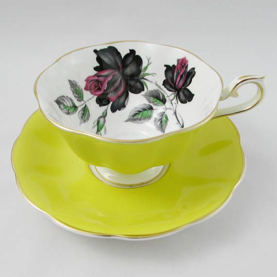 Beautiful bone china tea cup and saucer set by Royal Albert. Teacup and saucer are bright yellow with large red and black roses. Gold trimming on cup and saucer edges. Excellent condition (see photos). The markings read: Royal Albert Bone China England Please bear in mind that these