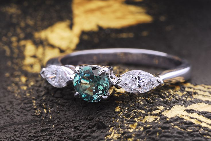 """""""Larisa"""" 0.45 carat natural Alexandrite engagement ring flanked by two marquise-shaped white diamonds."""