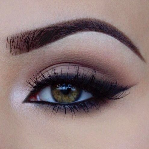 Neutral shadows with winged liner.