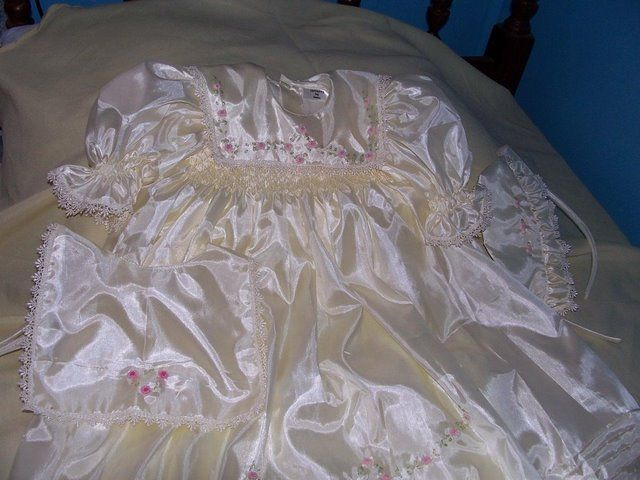 Robin smocked ivory silk a cutiepye creation 85cm long smocked with hand embroidery 0427820744