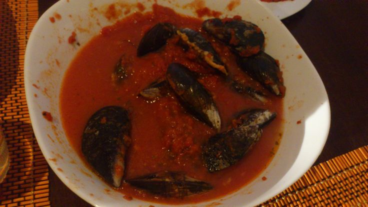 Stuffed mussels in tomatos sauce. To stuff the mussels: soaked breadcrumbs, grated pecorino cheese, salt, pepper, egg, chopped parsley and garlic. Then fill the mussels and close rolling a cotton thread around the mussel. Enjoy it!