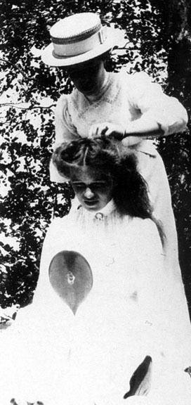 Grand Duchess Olga Romanov getting her hair done.