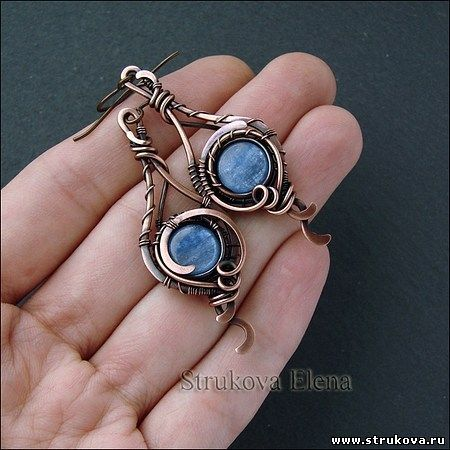 Pretty. I really like that color of blue, and the wirework is real nice.