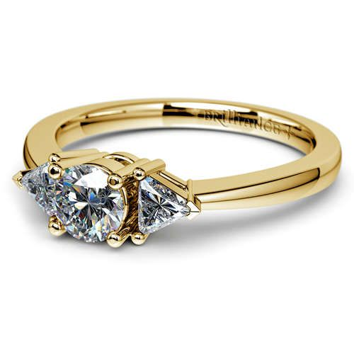Check out this simply breathtaking new Brilliance beauty... The Trillion Diamond Ring in timeless Yellow Gold! Pop the question with this ring's elegant sparkle--she'll be speechless! http://www.brilliance.com/engagement-rings/trillion-diamond-ring-yellow-gold