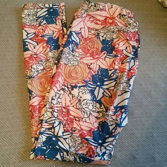 TC Lularoe floral leggings Super cute tc floral leggings. Pinks blues and whites. Fits sizes 12-22. They are too big for me. Only worn one time. LuLaRoe Pants Leggings