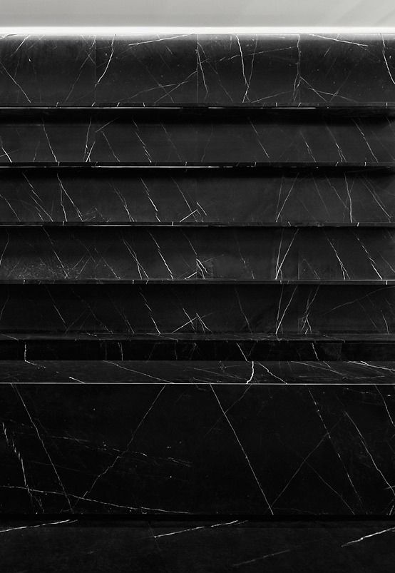 Black marble shelving in the Saint Laurent Paris store in Shanghai, by Hedi Slimane.