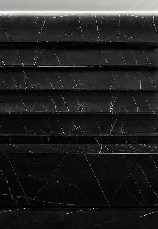 Black marble shelving in the Saint Laurent Paris store in Shanghai, by Hedi Slimane.