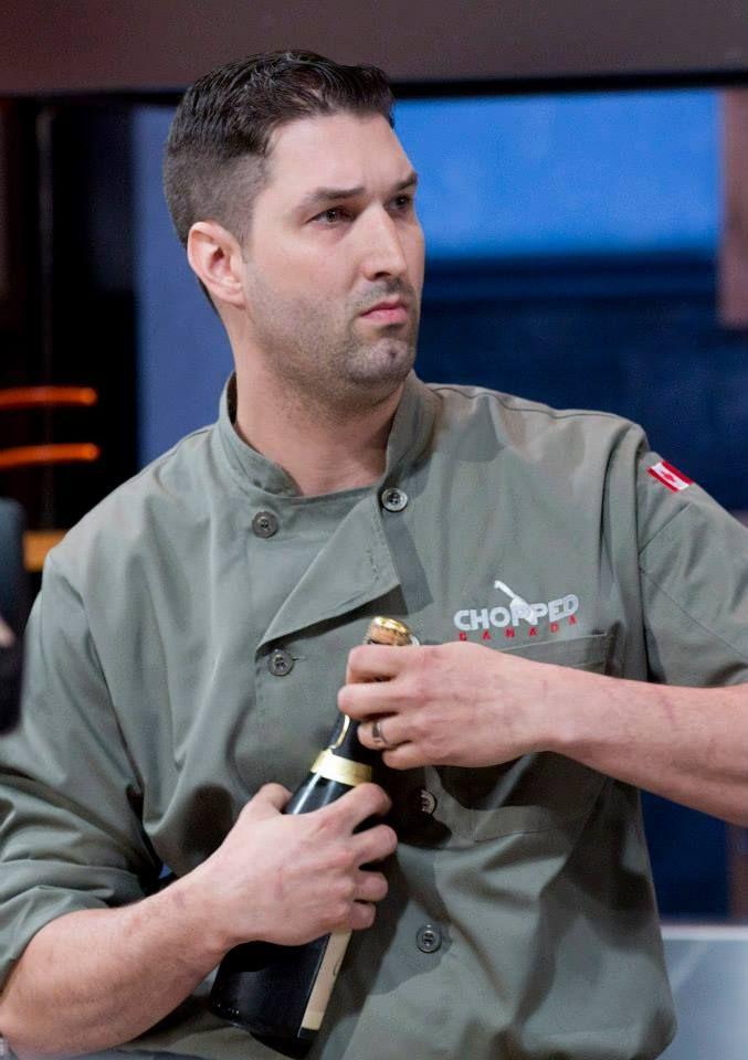 Chef Alex prepares to pop a little bubbly.