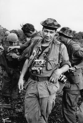 Photojournalist Eddie Adams with the Nikon S3 and Leica in Vietnam. Eddie's most famous photograph was taken while covering the Vietnam War for the Associated Press that he took his best-known photograph – the picture of police chief General Nguyễn Ngọc Loan executing a Vietcong prisoner, Nguyễn Văn Lém, on a Saigon street, on February 1, 1968, during the opening stages of the Tet Offensive.
