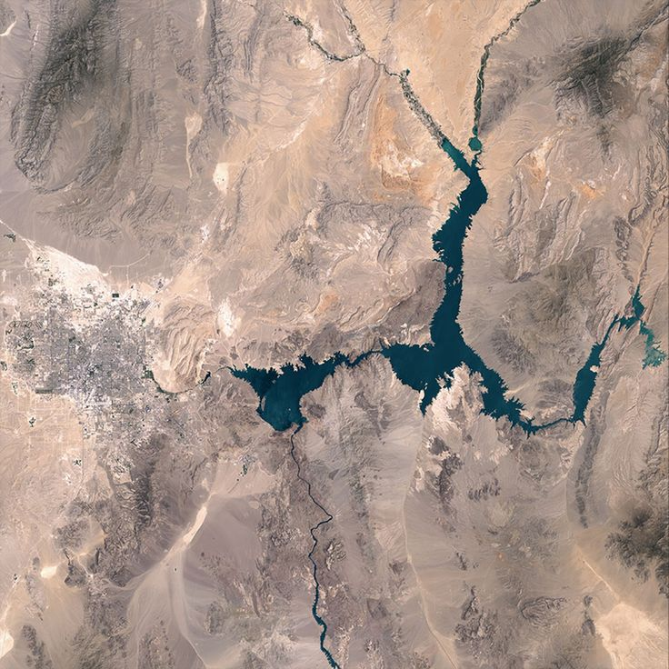 Reservoir at Risk:  LAKE MEAD, which depends on snowmelt from the Rockies, has seen its water levels plummet due to drought and increased demand.  - photo from July 6, 2000, NASA Earth Observatory  ...Compare to the 2015 photo of the same location...