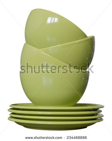 green porcelain bowls and plates isolated on white - stock photo