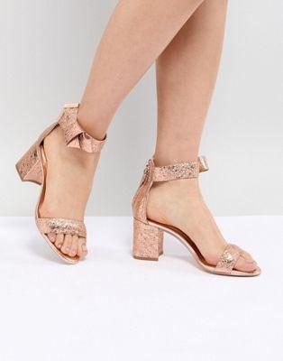 80557daf4 Shop Ted Baker Kerrias Rose Gold Leather Block Heeled Sandal at ASOS.  Discover fashion online.